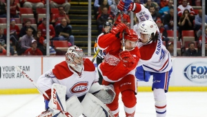 Montreal Canadiens defenseman Mark Barberio (45) defends Detroit Red Wings center Luke Glendening (41) as goalie Carey Price (31) looks on in the second period of an NHL hockey game, Monday, Jan. 16, 2017, in Detroit. (AP Photo/Paul Sancya)