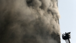 Iranian firefighters work to extinguish fire of the Plasco building in central Tehran, Iran on Thursday, Jan. 19, 2017. (AP / Vahid Salemi)