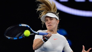 Canada's Eugenie Bouchard makes a forehand return to United States' Coco Vandeweghe during their third round match at the Australian Open tennis championships in Melbourne, Australia, Friday, Jan. 20, 2017. (AP Photo/Andy Brownbill)