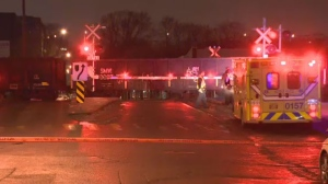 A 23-year-old woman was taken to hospital after being struck by a train while crossing tracks located near De Courcelle St. and Acorn.