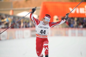 Alex Harvey of Canada crosses the finish line to win the men's 15km free style competition at the FIS Cross Country skiing World Cup event in Ulricehamn, Sweden, Saturday Jan. 21, 2017. (Adam Ihse / TT via AP)
