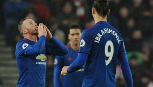 Manchester United's Wayne Rooney, left, celebrates after scoring from a free kick during the English Premier League soccer match between Stoke City and Manchester United at the Britannia Stadium, Stoke on Trent, England, Saturday, Jan. 21, 2017. (AP Photo/Rui Vieira)