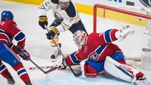Buffalo Sabres' Evander Kane (9) moves in on Montreal Canadiens goaltender Carey Price as Canadiens' Max Pacioretty defends during first period NHL hockey action in Montreal, Saturday, January 21, 2017. THE CANADIAN PRESS/Graham Hughes