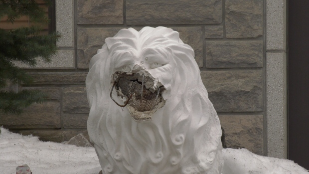 A vandalized lion statue at the Quan Am temple