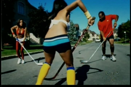 In the ad, Montreal Canadien Georges Laraque plays street hockey against a team of scantily-clad women.
