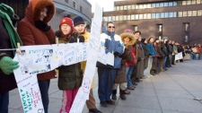 Participants form a human chain during a memorial for the victims of the Ecole Polytechnique shooting in Montreal, Sunday, December 6, 2009. (Ryan Remiorz / THE CANADIAN PRESS)