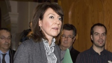 Quebec Deputy Premier Nathalie Normandeau walks out of Question Period on Thursday, Nov.19, 2009 at the Quebec legislature in Quebec City. (Jacques Boissinot / THE CANADIAN PRESS)
