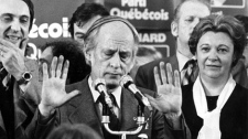 Quebec Premier Rene Levesque tries to hush supporters at a Parti Quebecois rally in Montreal, Nov.15, 1976, following his party's victory over the Liberal party of Robert Bourassa in the provincial election. It was a meaningless mid-November game whose only memorable play occurred in the stands, yet decades later it still illustrates more than any Stanley Cup-winning heroics what the Montreal Canadiens have meant to their city. (THE CANADIAN PRESS/ Files)