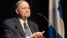 Former Quebec premier Jacques Parizeau applauds in Montreal on November 5, 2009. (Ryan Remiorz / THE CANADIAN PRESS)