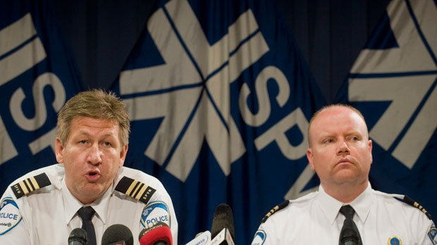 Denis Mainville, left, and Ian Lafreniere, of the Montreal police department, speak to reporters at a news conference in Montreal Tuesday, June 5, 2012 about the arrest of Luka Rocco Magnotta, who is the main suspect in the killing of Chinese student Jun Lin.    (AP Photo/The Canadian Press,Graham Hughes )