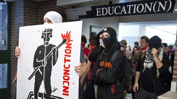 Protesters make their way through the hall of a Montreal university to disrupt classes Wednesday, May 16, 2012 in Montreal. THE CANADIAN PRESS/Paul Chiasson