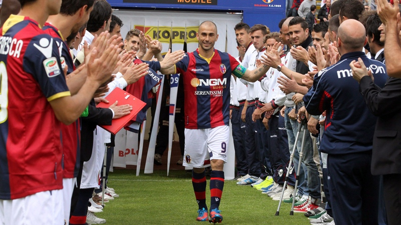 Bologna's Marco Di Vaio is applauded by teammates as he enters he pitch prior to a Serie A soccer match between Bologna and Napoli at Bologna's Renato Dall' Ara stadium, Italy, Sunday, May 6, 2012. Di Vaio announced that he would leave Bologna at the end of the season and said he got an offer from Montreal Impact. (AP Photo/Studio FN)