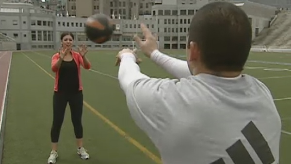 Two students demonstrate one way of using a medicine ball (May 28, 2012)