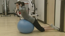 An exercise psychology student demonstrates how to use a stability ball (May 28, 2012)