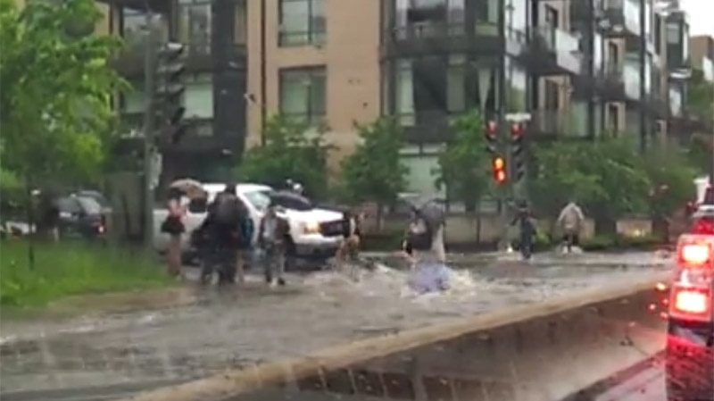 This video still image of a flooded intersection in Lachine was provided by MyNews contributor David Dallaire.