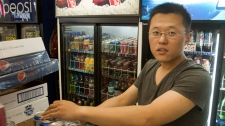 Kankan Huang stock the shelves of his store in Montreal on Friday, June 1, 2012. Police have identified his employee, Jun Lin, as the victim of the grisly murder and dismemberment earlier this week. THE CANADIAN PRESS/Ryan Remiorz