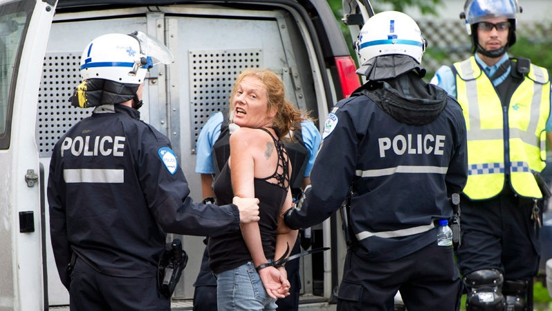 Police arrest a demonstrator trying to disrupt the opening gala at the Canadian Grand Prix in Montreal on Thursday, June 7, 2012. (Paul Chiasson / THE CANADIAN PRESS)