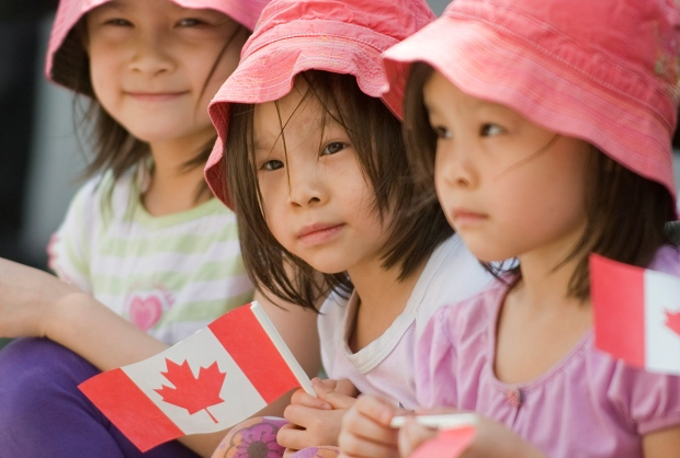 Kids enjoy the annual Canada Day parade in Montreal, Sunday, July 1, 2012. THE CANADIAN PRESS/Graham Hughes