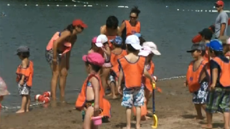 The kids were sporting orange at the beach Thursday.