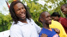 NHL player Georges Laraque jokes around with a Haitian boy outside Grace Children's Hospital in Port-au-Prince, Haiti, Tuesday, June 8, 2010. The NHL Players' Association donating more than $1 million to help rebuild a hospital in Haiti. (NHLPA / THE CANADIAN PRESS)
