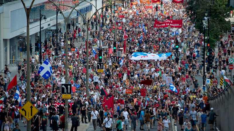 Thousands of people take to the streets in a mass demonstration against the Quebec Liberal government's policies in Montreal, Sunday, July 22, 2012. (Peter McCabe / THE CANADIAN PRESS)