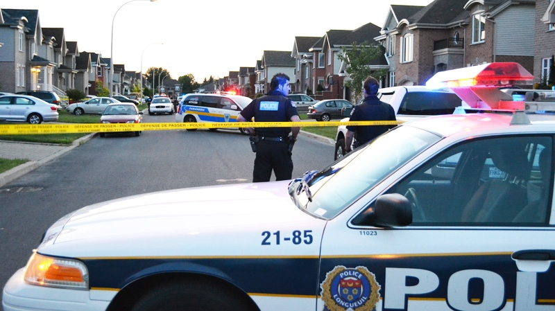 Longueuil police were on the scene early Sunday morning to start an investigation into the suspicious death. (Photo: Cosmo Santamaria)