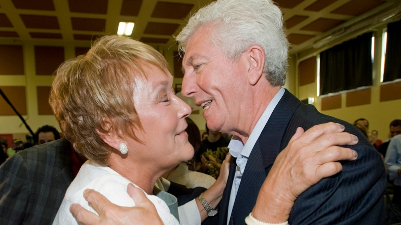 Parti Quebecois Leader Pauline Marois greets former leader of the Bloc Quebecois Gilles Duceppe during an election campaign stop in Montreal on Saturday, August 4, 2012. THE CANADIAN PRESS/Graham Hughes