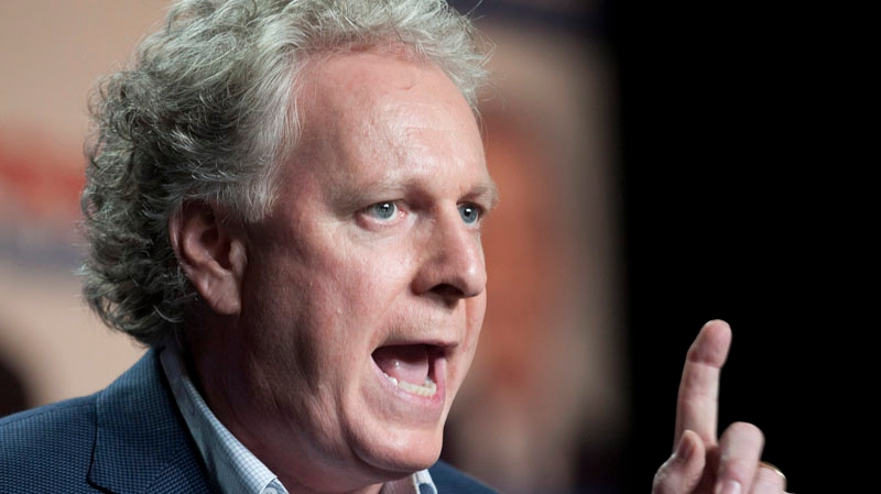 Quebec Liberal Party Leader Jean Charest speaks at a rally Saturday, August 4, 2012 Quebec City. Quebecers will be voting in a general election on Sept. 4. THE CANADIAN PRESS/Jacques Boissinot