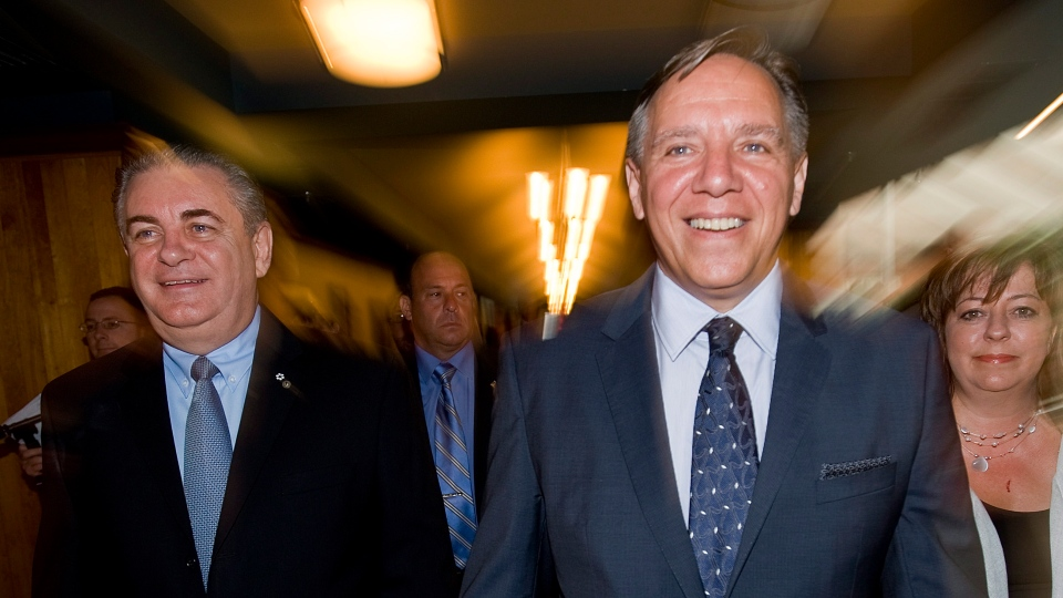 Coalition Avenir Quebec leader Francois Legault, right, and CAQ candidate for the riding of Saint-Jerome Jacques Duchesneau, left, arrive for a news conference during an election campaign stop in Saint-Jerome, Que., Sunday August 5, 2012. THE CANADIAN PRESS/Graham Hughes