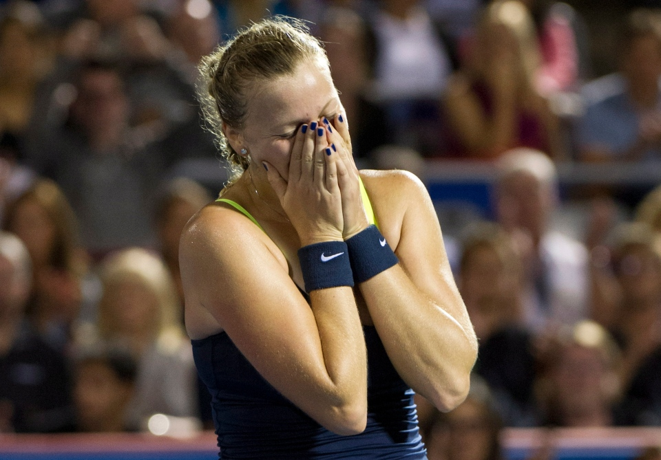 Petra Kvitova from the Czech Republic reacts after beating Li Na from China during the final at the Rogers Cup tennis tournament Monday, August 13, 2012 in Montreal. THE CANADIAN PRESS/Paul Chiasson