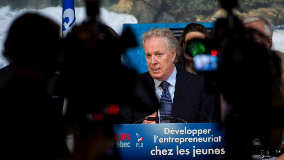 Quebec Premier Jean Charest responds to a question during a news conference Wednesday, August 15, 2012 in Sherbrooke, Que. THE CANADIAN PRESS/Paul Chiasson