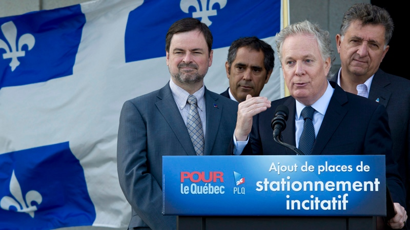 Quebec Premier Jean Charest responds to a question during a news conference Saturday, August 18, 2012 in Laval, Que. THE CANADIAN PRESS/Paul Chiasson