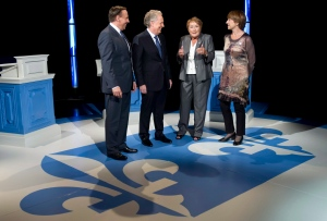 Coalition de L'Avenir du Quebec leader Francois Legault, Quebec Premier Jean Charest, PQ leader Pauline Marois and Quebec Solidaire co-leader Francoise David, left to right, chat on the set prior to the leaders debate Sunday, August 19, 2012 in Montreal. THE CANADIAN PRESS/Paul Chiasson