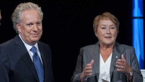 Quebec Premier Jean Charest and Parti Quebecois leader Pauline Marois pose for a photograph prior to the leaders debate in Montreal, Sunday, August 19, 2012. THE CANADIAN PRESS/Graham Hughes