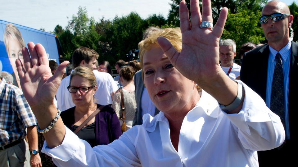 PQ leader Pauline Marois greets supporters during a campaign stop Sunday, September 2, 2012 in St-Jerome, Que. Quebecers go to the polls Tuesday to election a new provincial government.THE CANADIAN PRESS/Paul Chiasson