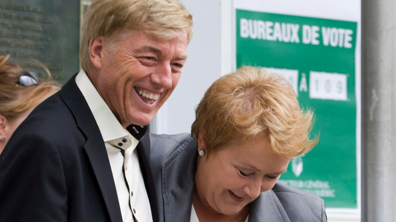 Parti Quebecois Leader Pauline Marois and her husband Claude Blanchet smile as they walk out of a polling station after voting in Beaupre, Que., on Tuesday, September 4, 2012. Quebecers are voting in a general election. THE CANADIAN PRESS/Jacques Boissinot