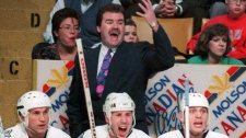 Then-Toronto Maple Leafs' head coach Pat Burns yells out instructions to his players on the ice during the second period of an NHL game against the Los Angeles Kings in Toronto on March 31, 1993. (THE CANADIAN PRESS)