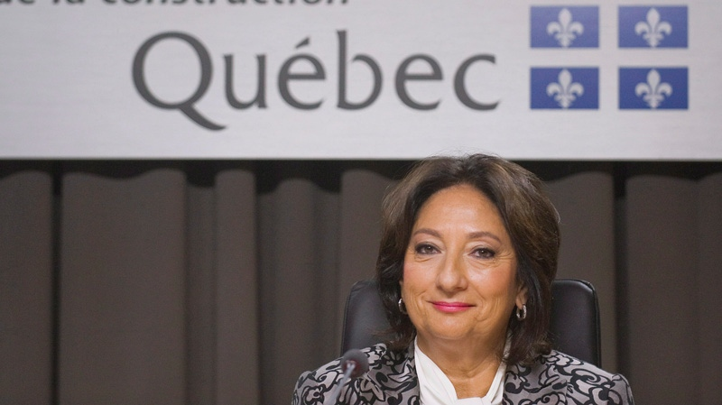 Justice France Charbonneau smiles as she sits on the opening day of a Quebec inquiry looking into allegations of corruption in the province's construction industry in Montreal, Tuesday, May 22, 2012. (THE CANADIAN PRESS/Graham Hughes)