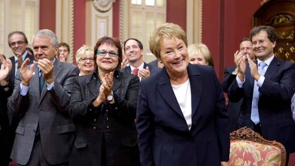Premier-designate Pauline Marois smiles as members and people applaud her before she is sworn in as legislature member for Charlevoix-Cote de Beaupre during a ceremony where the 54 elected members of the Parti Quebecois are sworn in Monday, September 17, 2012 at the legislature in Quebec City. (Jacques Boissinot / THE CANADIAN PRESS)