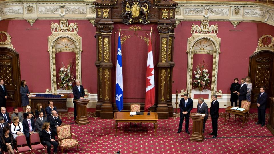 Coalition Avenir Quebec members during a swearing in ceremony of the 19 CAQ members at the legislature in Quebec City, Tuesday, Sept. 18, 2012.  (Jacques Boissinot / THE CANADIAN PRESS)