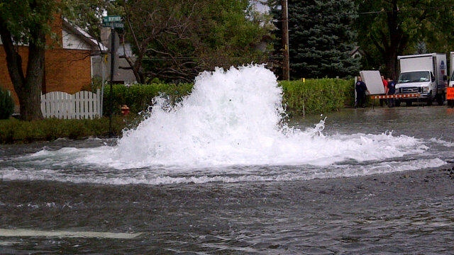 Water gushing from a broken water main in Longueuil on the morning of Sept. 19, 2012.