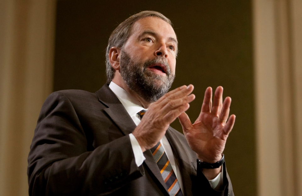 NDP Leader Thomas Mulcair speaks to party caucus members on Parliament Hill in Ottawa, Wednesday, Sept. 19, 2012. (Adrian Wyld / THE CANADIAN PRESS)