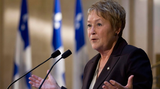 Quebec Premier Pauline Marois announces the cancellation of tuition hikes at a news conference Thursday, September 20, 2012 at the legislature in Quebec City. (The Canadian Press/Jacques Boissinot)