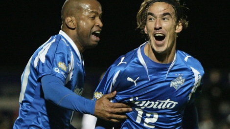 Montreal Impact's Eduardo Sebrango, right, celebrates his game-winning goal with Roberto Brown during second half action against the Vancouver Whitecaps in game one of the USL First Division soccer final in Burnaby, B.C., on Saturday October 10, 2009. Montreal won 3-2. The championship will be decided over two games with the teams playing game two on October 17 in Montreal. THE CANADIAN PRESS/Darryl Dyck