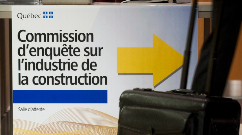 A lawyer arrives at the Charbonneau commission in Montreal, September 27, 2012, which is an inquiry looking into corruption and collusion in Quebec's construction industry. THE CANADIAN PRESS/Graham Hughes