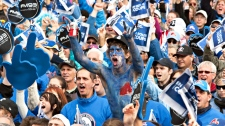 "Over 60,000 people, mostly dressed in blue, gather on the Plains of Abraham in a gathering called ""La Marche Bleue"" asking for a comeback of an NHL team in the city and a new arena in Quebec City, Saturday, October 2, 2010. (Jacques Boissinot / THE CANADIAN PRESS)"