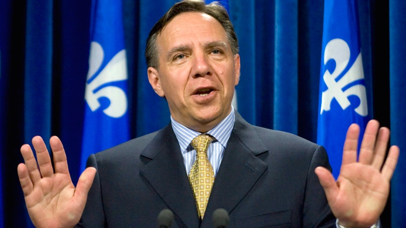 Then-Parti Quebecois legislature finance critic Francois Legault announces his resignation Thursday, June 25, 2009 at the Quebec legislature. (Jacques Boissinot / THE CANADIAN PRESS)