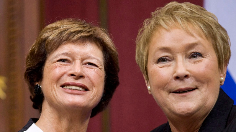 Quebec Premier Pauline Marois poses with Education Minister Marie Malavoy as she introduces members of her cabinet during a ceremony Wednesday, September 19, 2012 at the legislature in Quebec City. THE CANADIAN PRESS/Jacques Boissinot